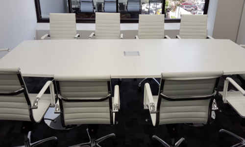 Custom Boardroom Table White with Chrome Pedestal Bases Front View